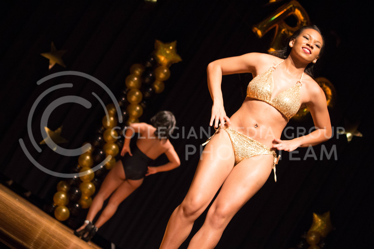 Melissa Riley, junior in Animal Science and Industry, models her swimsuit during the swimwear contest at the 18th Annual Black and Gold Pagent at the student union on Dec. 3.<br /> ( Alanud Alanazi | The Collegian)