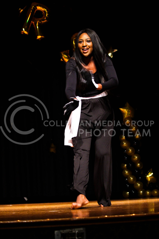 Tinaris Watson, sophomore in Hospitality Management, recites her original poem during the talent portion at the 18th Annual Black and Gold Pagent at the student union on Dec. 3.<br /> ( Alanud Alanazi | The Collegian)