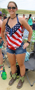 Caryn Welch, Topeka resident, shows off her cowboy boots on day three of Country Stampede on June 25, 2016. (Miranda Snyder | The Collegian)