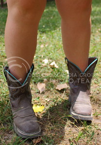 Nicole Conn, Mayview, MO resident, shows off her cowboy boots on day three of Country Stampede on June 25, 2016. (Miranda Snyder | The Collegian)