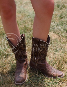 Hall says her favorite thing about her boots is the comfort on day three of Country Stampede on June 25, 2016. (Miranda Snyder | The Collegian)
