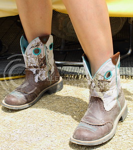 Macila Arnold, Leavenworth resident, shows off her cowboy boots on day three of Country Stampede on June 25, 2016. (Miranda Snyder | The Collegian)