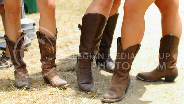 Nemeth, Wieden, Taylor show off their cowboy boots on day three of Country Stampede on June 25, 2016. (Miranda Snyder | The Collegian)