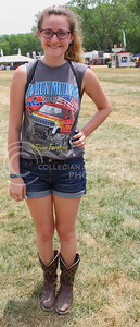 Kallie Hall, Lee Summit resident, shows off her cowboys boots on day three of Country Stampede on June 25, 2016. (Miranda Snyder | The Collegian)