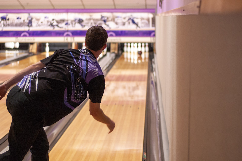 The moment of impact. Anticipating the strike Noah Modean watches as his ball goes hurtling towards the pins while practicing with the bowling team at Wabash Canon Bowl in the Union.  Modean is a senior in management and also a member of the K-State Bowling team. (Photo by Rowan Jones)