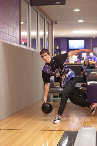 Noah Modean hurls the bowling ball down lane while at Wabash Canon Bowl in the Union. Modean, senior in management is also a member of the Kansas State Bowling team. (Photo by Rowan Jones)