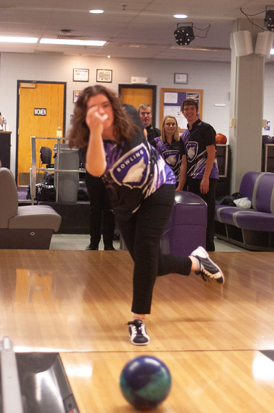 Lauren Laverly, Garret Winter and Joe Tillery (background) watch as Molly Killilea (foreground) practices at the Unions Wabash Canon Bowl. All of students are a part of the Kansas State bowling team and practices every Tuesday at the Union. (Photo by Rowan Jones)