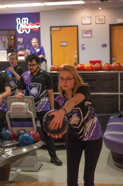 Focusing down-range Lauren Laverly, sophomore in nutritional sciences, practices her form in the Wabash Canon Bowl at the Union. Laverly is a member of the Kansas State bowling team who meet every Tuesday in the Union. (Photo by Rowan Jones)