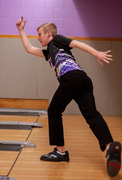 With finger pointed up high Joe Tillery, freshman in journalism, watches as his bowling ball speeds down the lane towards the pins. Tillery is a member of Kansas State bowling team who meet every Tuesday at Wabash Canon Bowl in the Union for practice.  (Photo by Rowan Jones)