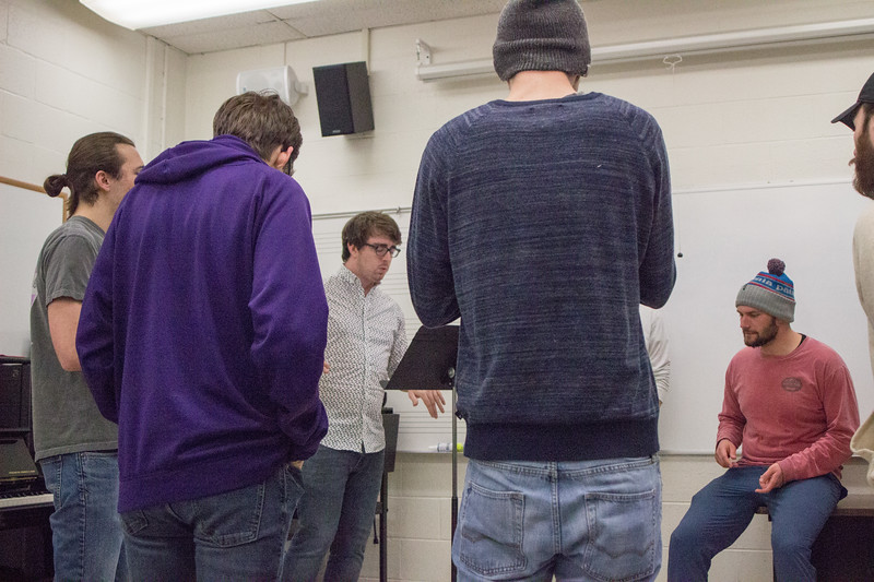 The members of Cadence Acappella practice one of their songs together during a rehearsal on February 27th. Cadence is an all-male acapella group here at K-State, they hold auditions every fall open to any men who love to sing. (Sarah Millard | Collegian Media Group)