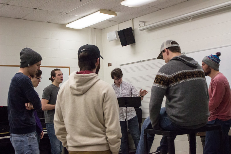 The members of Cadence Acappella practice one of their songs together during a rehearsal on February 27th. Cadence is an all-male acapella group here at K-State, they hold auditions every fall open to any men who love to sing.(Sarah Millard | Collegian Media Group)