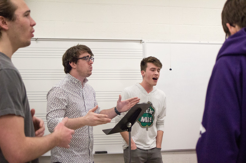 Sterling Oliver, a senior theatre major, and Joey Wiederholt, a junior, sing with the rest of Cadence during a rehearsal on February 27th. Cadence is an all-male acapella group here at K-State, they hold auditions every fall open to any men who love to sing. (Sarah Millard | Collegian Media Group)