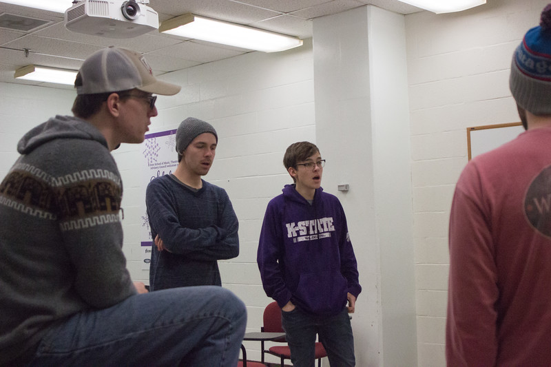 Dennis Truman, junior in mechanical engineering, Sam DeVeney, sophomore in psychology, and Spencer Bosley, sophomore in computer science sing with the rest of Cadence during their rehearsal on February 27th. Cadence A Capella is an all-male acapella group here at K-State. (Sarah Millard | Collegian Media Group)