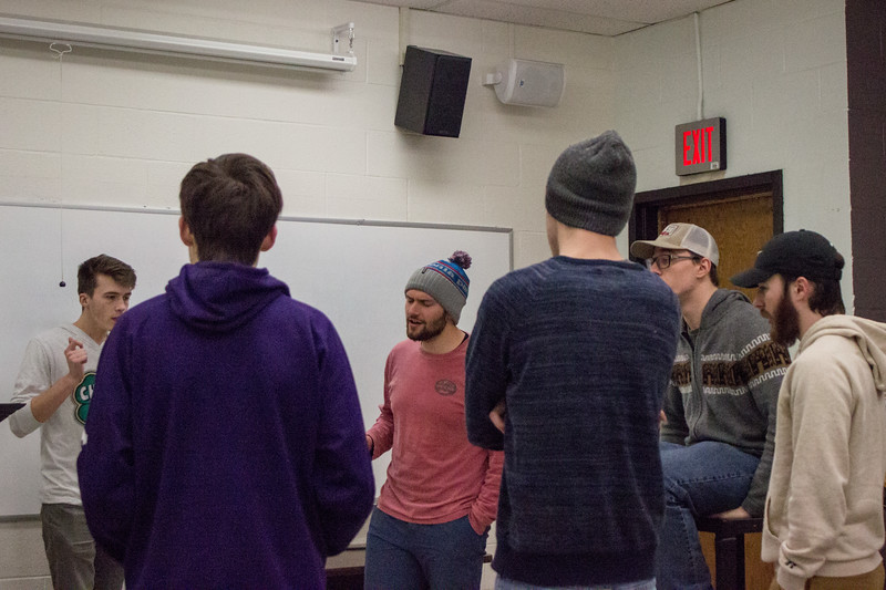 The members of Cadence A Cappella practice one of their songs together during a rehearsal on February 27th. Cadence is an all-male acapella group here at K-State, they hold auditions every fall open to any men who love to sing. (Sarah Millard | Collegian Media Group)