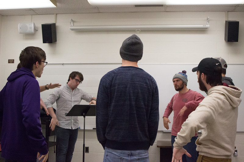The members of Cadence Acappella practice one of their songs together during a rehearsal on February 27th. The all-male acapella group encourages a very relaxed environment and its members all have fun during rehearsals. (Sarah Millard | Collegian Media Group)