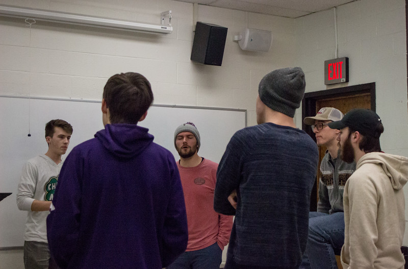 The members of Cadence A Cappella practice one of their songs together during a rehearsal on February 27th. Cadence A Capella is an all-male acapella group here at K-State, they hold auditions every fall open to any men who love to sing. (Sarah Millard | Collegian Media Group)