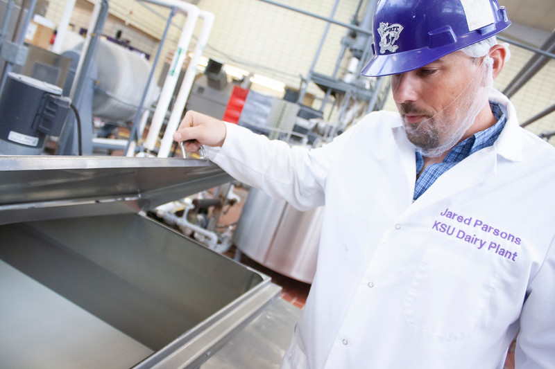 Jared Parsons, dairy plant manager, looks at the plant's basic liquid white mix, which includes butterfat, sugar and other ingredients that go into ice cream, on Tuesday, April 24, 2018, in Call Hall. (Tiffany Roney | Collegian Media Group)
