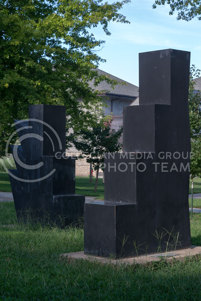 The black scuptures entitled 'Kreqe-aekyed and Kqrefe-aekyad' remain standing on August 9, 2016 in front of Thompson Hall. (Evert Nelson | The Collegian)