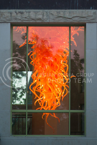 The scupture 'Chandelier' by Dale Chihuly radiates its orange glow through the windows of the Marianna Kistler Beach Museum of Art on August 9, 2016. (Evert Nelson | The Collegian)