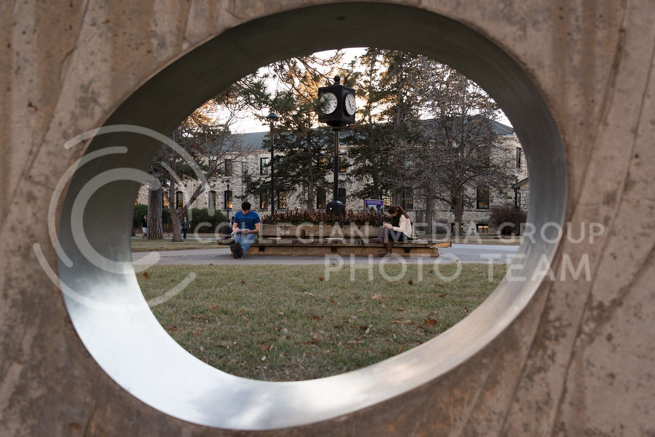 Students study on the benches connected to the clock tower in the Cauffman Commons area of campus on January 26, 2015. (Evert Nelson | The Collegian)