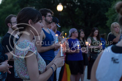 Supporters and mourners of the victims of the shooting in Orlando, Florida gather with lit candles at City Park in Manhattan, Kansas on June 12, 2016. (Sarah Falcon | The Collegian)