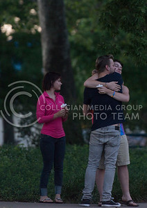 Nathaniel Eldridge, a Manhattan resident, hugs Cody Filbert, sophomore in hospitality management, following the candlelight vigil in City Park on June 12, 2016. (George Walker | The Collegian)