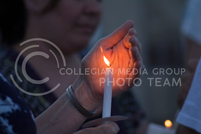 A candlelight vigil was held at City Park in Manhattan, Kansas on June 12, 2016. The event was held to honor and mourn the victims of the shooting in Orlando, Florida. (Sarah Falcon | The Collegian)