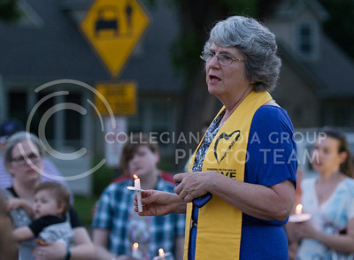 After leading the group in song, Jonalu Johnstone, reverend at the Unitarian Universalist Fellowship, speaks during the candlelight vigil in City Park on June 12, 2016. About 75 people attended the vigil. (George Walker | The Collegian)
