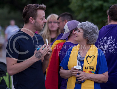 Nathaniel Eldridge, a Manhattan resident, speaks with Reverend Jonalu Johnstone of the Unitarian Universalist Fellowship before the start of the candlelight vigil in City Park on June 12, 2016. The two were the main speakers at the vigil. (George Walker | The Collegian)