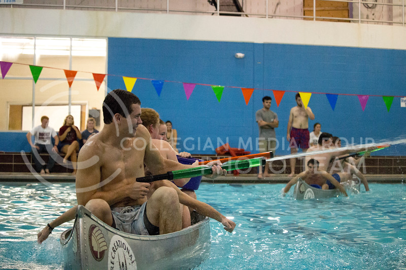teams shoot water at each other during the Canoe Battleship held by K-State student Union Program Council on Sept. 8, 2017 in the K-State's Natatorium. (Alanoud Alanazi   Collegian Media Group)