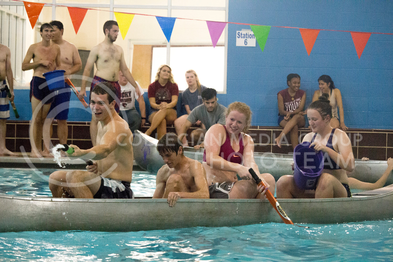 team player shoot water at opposing teams during the Canoe Battleship held by K-State student Union Program Council on Sept. 8, 2017 in the K-State's Natatorium. (Alanoud Alanazi | Collegian Media Group)