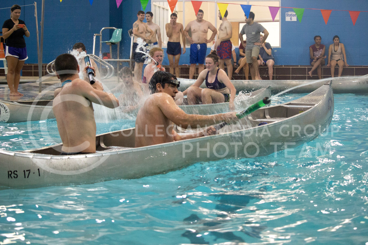 teams shoot water at each other during the Canoe Battleship held by K-State student Union Program Council on Sept. 8, 2017 in the K-State's Natatorium. (Alanoud Alanazi | Collegian Media Group)