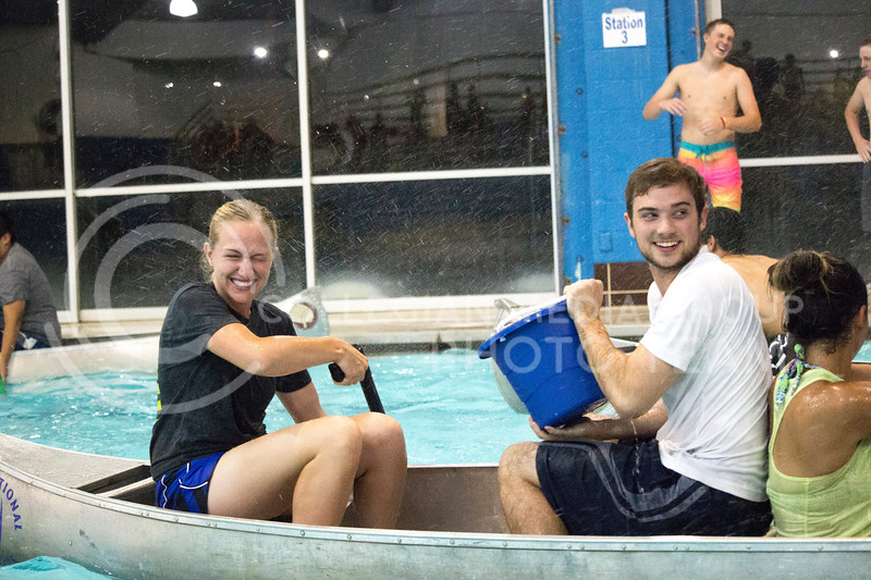 Team players prepare to shoot water at other teams during the Canoe Battleship held by K-State student Union Program Council on Sept. 8, 2017 in the K-State's Natatorium. (Alanoud Alanazi   Collegian Media Group)