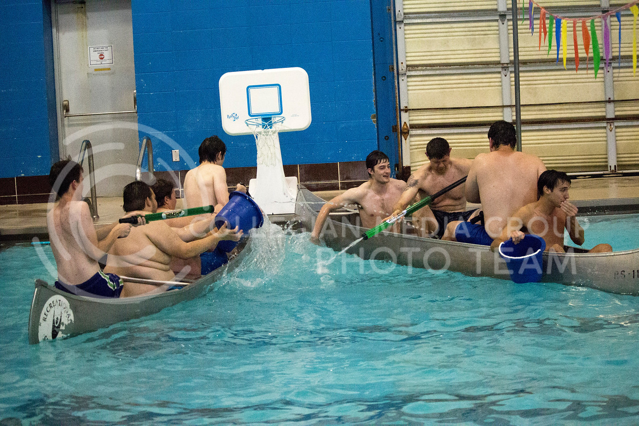 teams prepare to shoot water at each other during the Canoe Battleship held by K-State student Union Program Council on Sept. 8, 2017 in the K-State's Natatorium. (Alanoud Alanazi | Collegian Media Group)