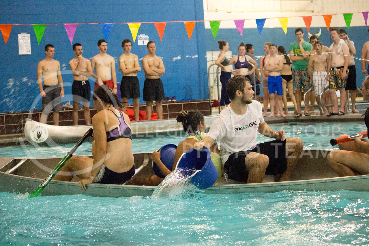 team player prepares to throw water at each oppsing teams during the Canoe Battleship held by K-State student Union Program Council on Sept. 8, 2017 in the K-State's Natatorium. (Alanoud Alanazi | Collegian Media Group)