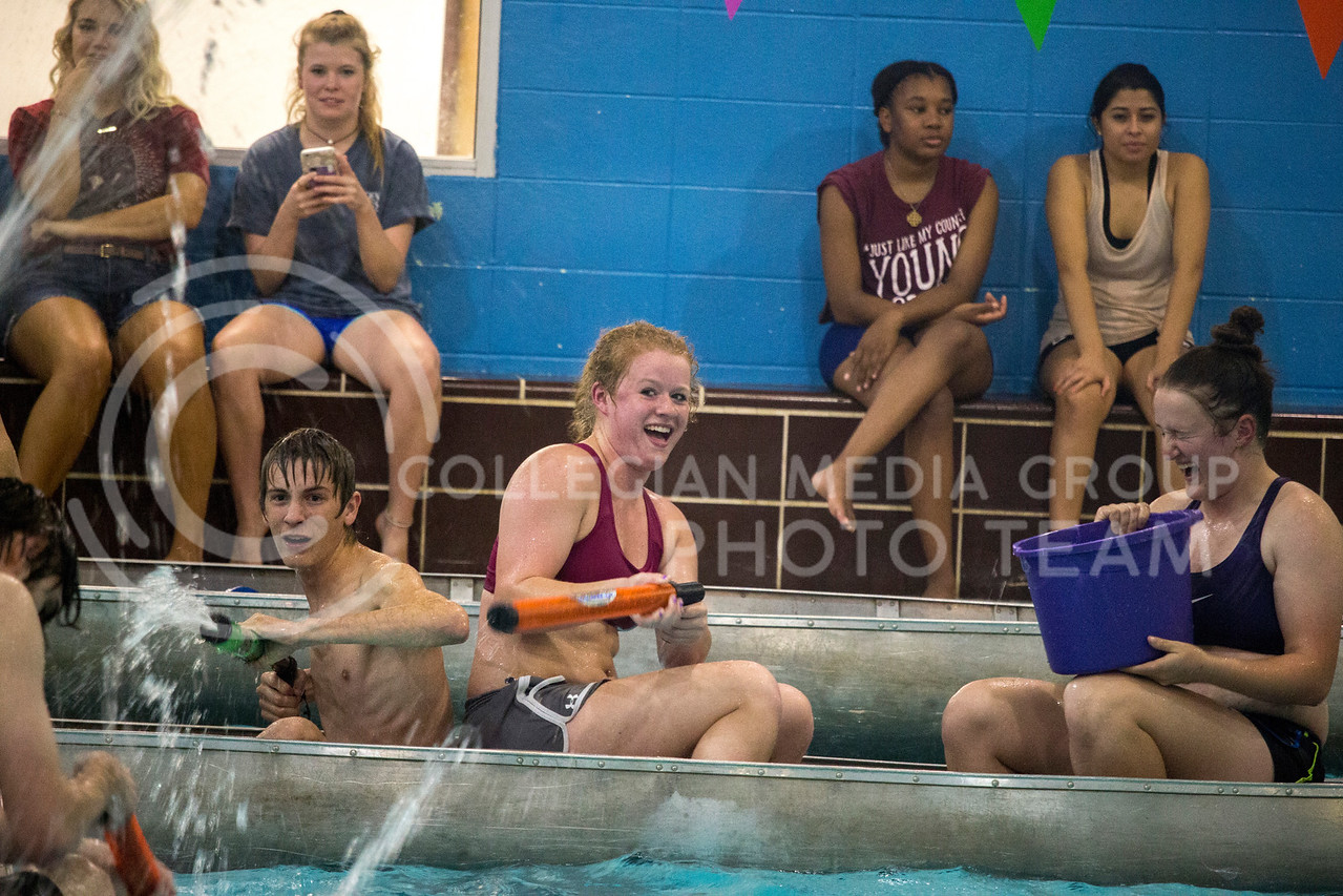 teams shoot water at each other teams during the Canoe Battleship held by K-State student Union Program Council on Sept. 8, 2017 in the K-State's Natatorium. (Alanoud Alanazi | Collegian Media Group)
