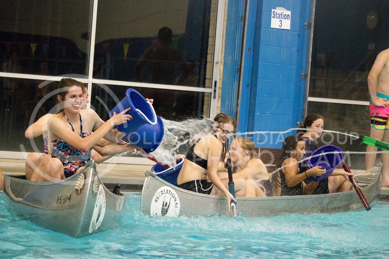 teams throw water at each other during the Canoe Battleship held by K-State student Union Program Council on Sept. 8, 2017 in the K-State's Natatorium. (Alanoud Alanazi | Collegian Media Group)