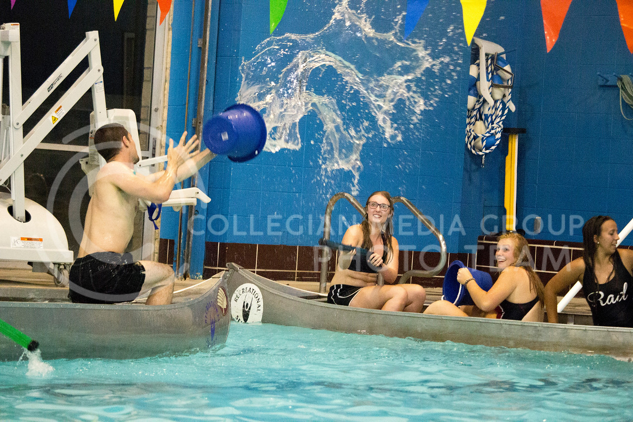 team player throws water at opposing team during the Canoe Battleship held by K-State student Union Program Council on Sept. 8, 2017 in the K-State's Natatorium. (Alanoud Alanazi | Collegian Media Group)