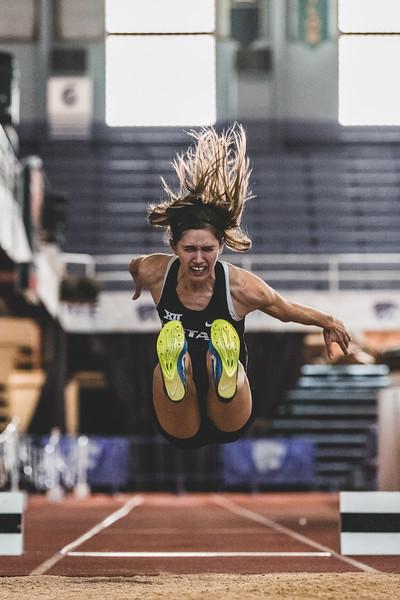 Bracing for impact, senior Morgan Coffman launches herself 4.91m during the women's long jump at the Carol Robinson/Attila Zsivoczky Pentathlon in Ahern on December 7, 2018. (Alex Todd   Collegian Media Group)