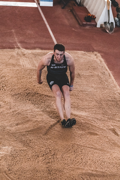 Feet entering the sand, K-State junior Kyle Parr travels a total distance of 6.51m in the long jump during the Carol Robinson/Attila Zsivoczky Pentathlon in Ahern on December 7, 2018. (Alex Todd   Collegian Media Group)