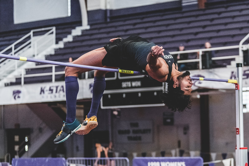 Curling over the crossbar, K-State sophomore Tejaswin Shankar successfully places first in the mens high jump at 2.12m during the Carol Robinson/Attila Zsivoczky Pentathlon in Ahern on December 7, 2018. (Alex Todd   Collegian Media Group)