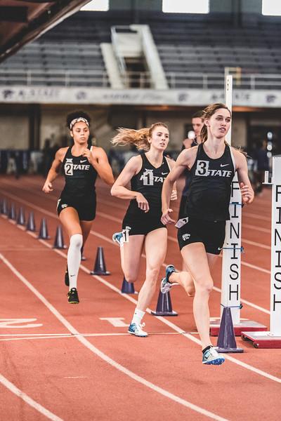 Crossing the finish line of the women's 800m race, senior Morgan Coffman gets a time of 2:20.96 at the Carol Robinson/Attila Zsivoczky Pentathlon in Ahern on December 7, 2018. (Alex Todd   Collegian Media Group)