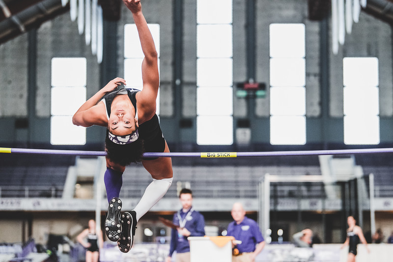 Looking back, K-State junior Ariel Okorie soars over the crossbar set at 1.64m during the hight jump at the Carol Robinson/Attila Zsivoczky Pentathlon in Ahern on December 7, 2018. (Alex Todd   Collegian Media Group)