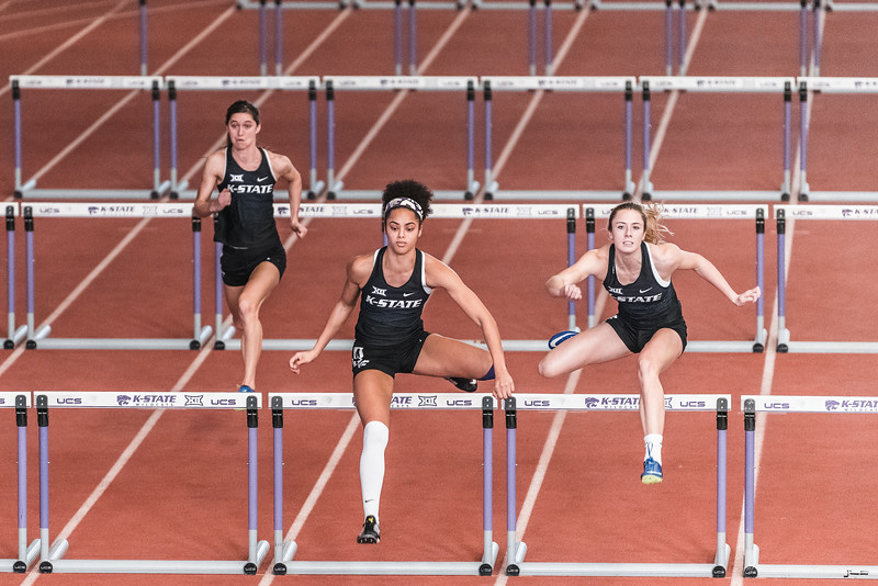 From left to right, Morgan Coffman, Ariel Okorie, and Laurn Taubert compete in the 60m hurdles during the Carol Robinson/Attila Zsivoczky Pentathlon in Ahern on December 7, 2018. Lauren Taubert won with a time of 8.62 seconds. (Alex Todd   Collegian Media Group)