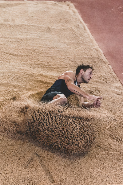 Spraying the sand with his landing, K-State senior Simone Fassina places 4th in the long jump during the Carol Robinson/Attila Zsivoczky Pentathlon in Ahern on December 7, 2018. (Alex Todd   Collegian Media Group)