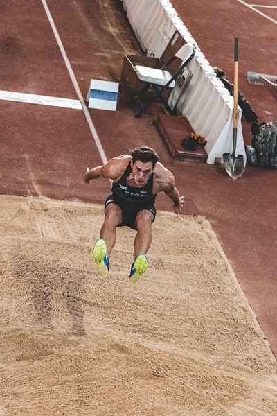 Senior Simone Fassina hovers over the sand, traveling 6.46m in the long jump during the Carol Robinson/Attila Zsivoczky Pentathlon in Ahern on December 7, 2018. (Alex Todd   Collegian Media Group)