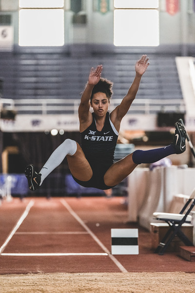Preparing to land, K-State junior Ariel Okorie hits the sand at 5.63m, placing first in the women's long jump during the Carol Robinson/Attila Zsivoczky Pentathlon in Ahern on December 7, 2018. (Alex Todd   Collegian Media Group)