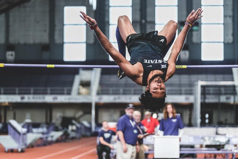 Upside down, sophomore Tejaswin Shankar clears 2.12m during the Carol Robinson/Attila Zsivoczky Pentathlon in Ahern on December 7, 2018. (Alex Todd   Collegian Media Group)