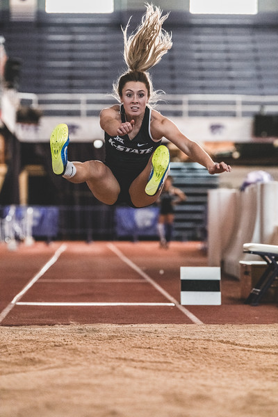 Leaping forward, K-State junior Lauren Taubert places second in the women's long jump with 5.20m during the Carol Robinson/Attila Zsivoczky Pentathlon in Ahern on December 7, 2018. (Alex Todd   Collegian Media Group)