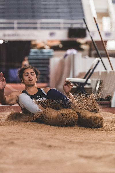 K-State junior Ariel Okorie lands in the sand while competing in the women's long jump during the Carol Robinson/Attila Zsivoczky Pentathlon in Ahern on December 7, 2018. (Alex Todd   Collegian Media Group)
